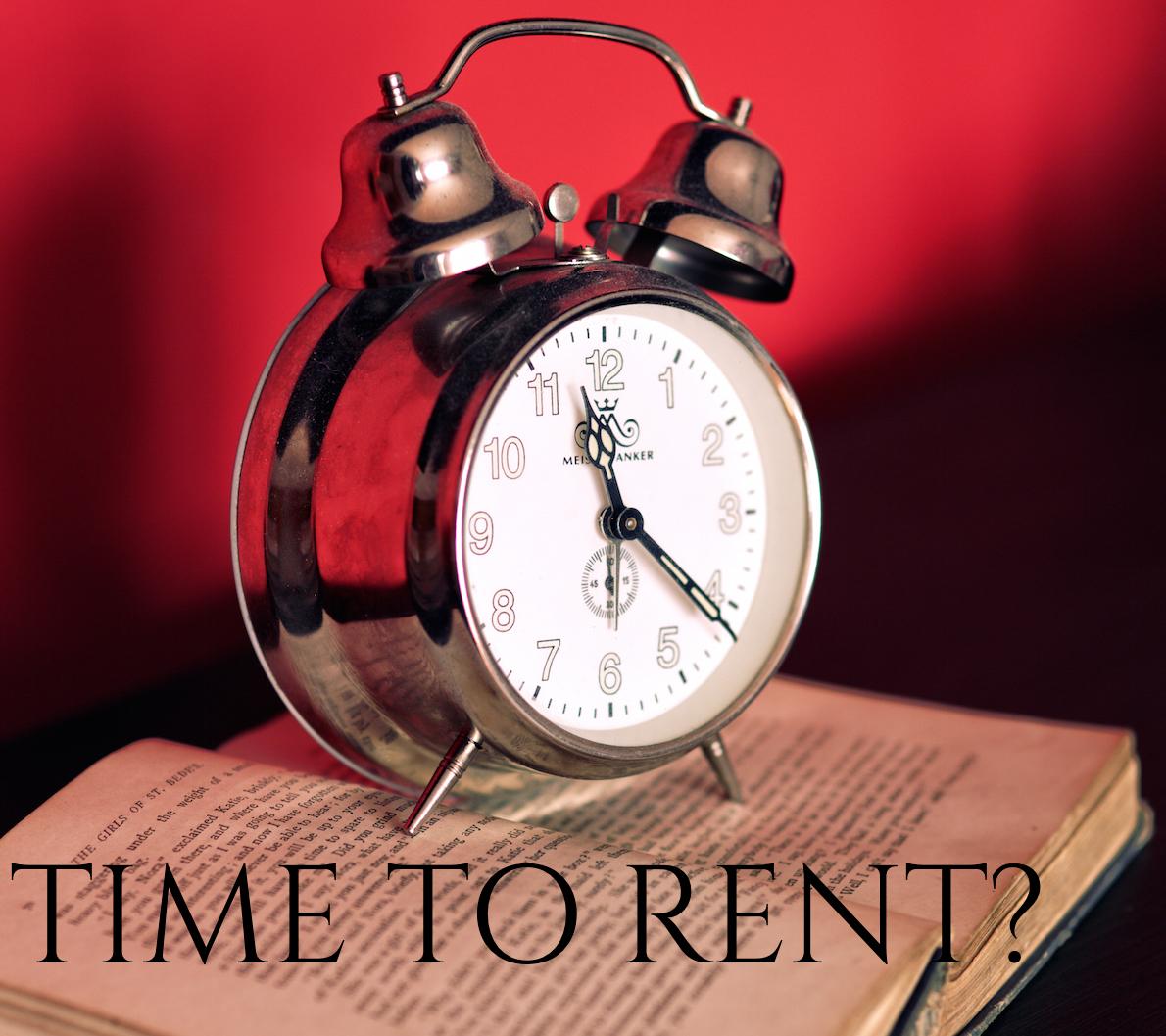 Alarm clock on open book