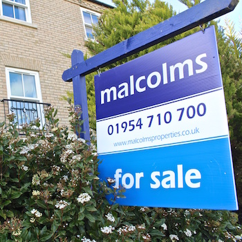 Malcolms estate agents 'For Sale' board