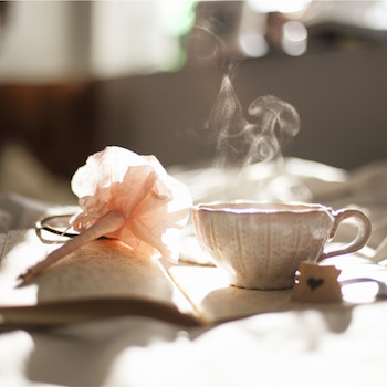 Pretty cup of tea and pen on diary