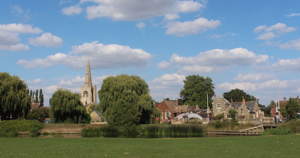 Village scene of Godmanchester, Cambridgeshire, with church, recreation ground and Chinese bridge