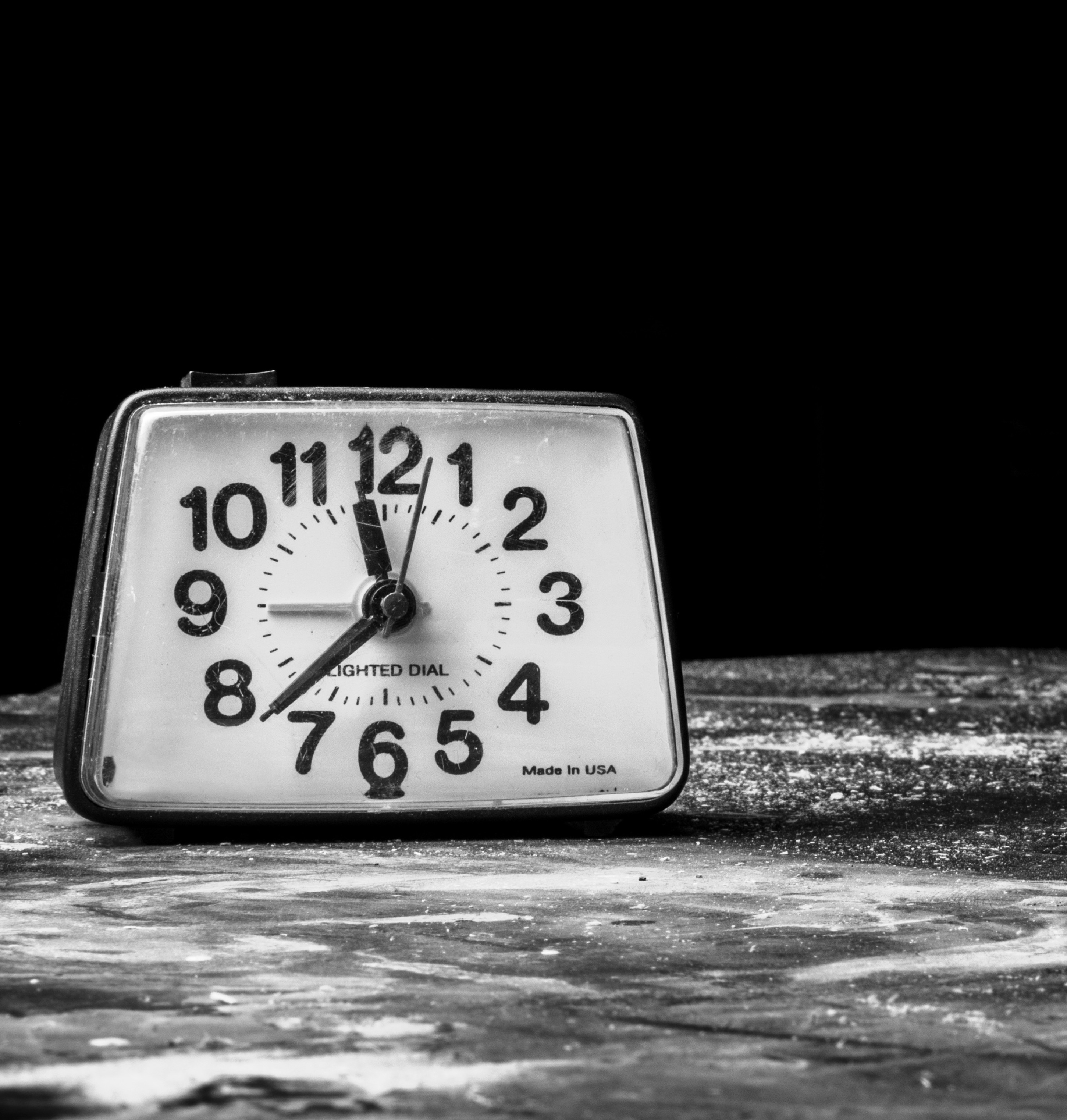 Ticking clock on grey surface